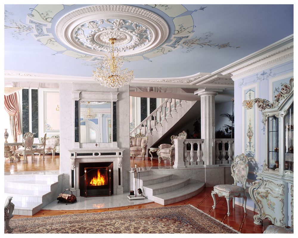 Luxurious countryhouse hall in Renaiisance style, finished with marble, stucco and carvings. Carved chairs, carpet and artificial fireplace compliment the environment