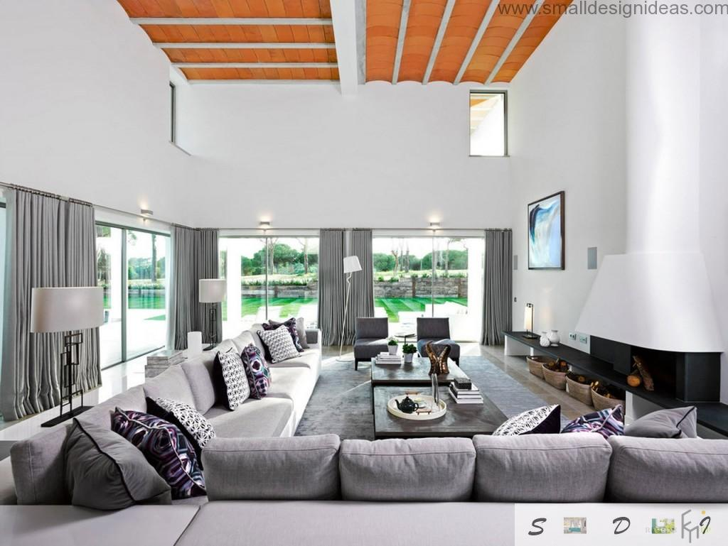Decorative interesting cross bars at the ceiling of the spacious light living room full of furniture and silver furniture