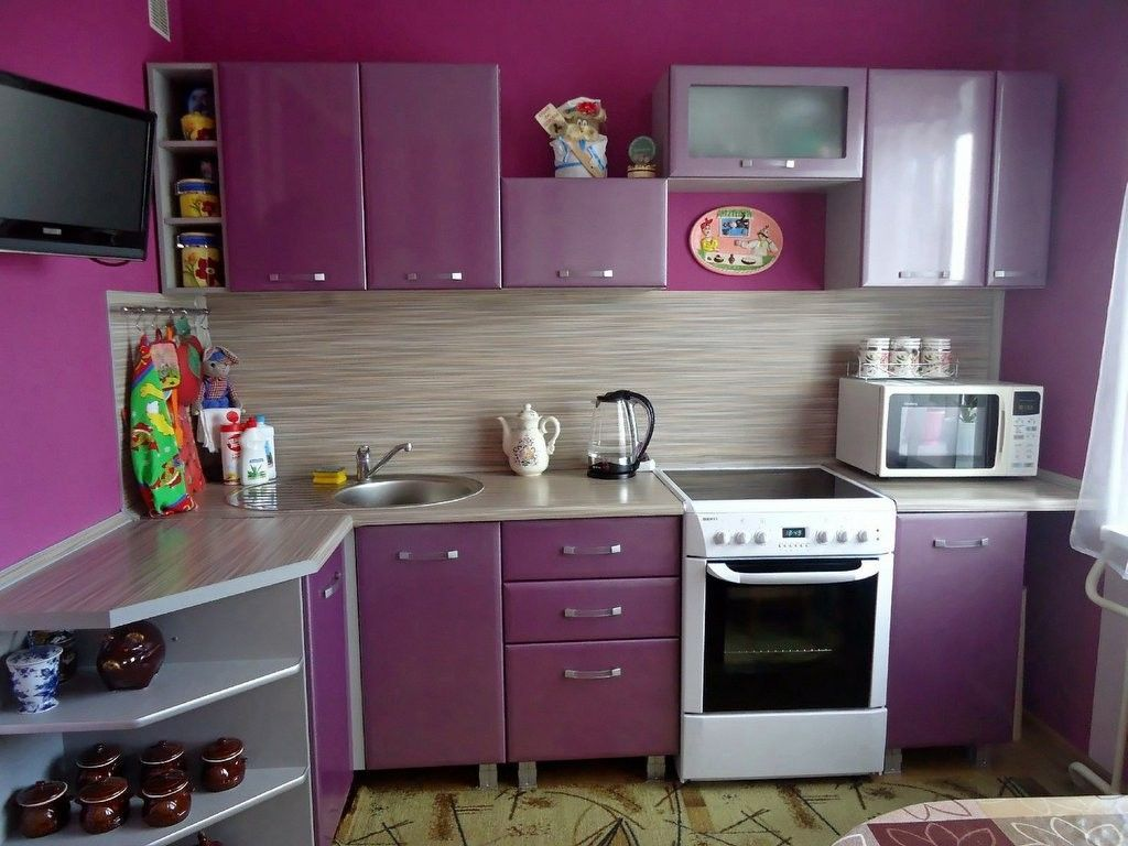 Nice purple design experiment in the small kitchen with contrasting white oven