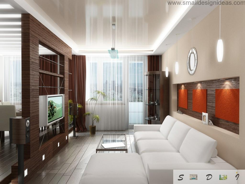 Light creamy living room with contrasting hazel wall with electronics
