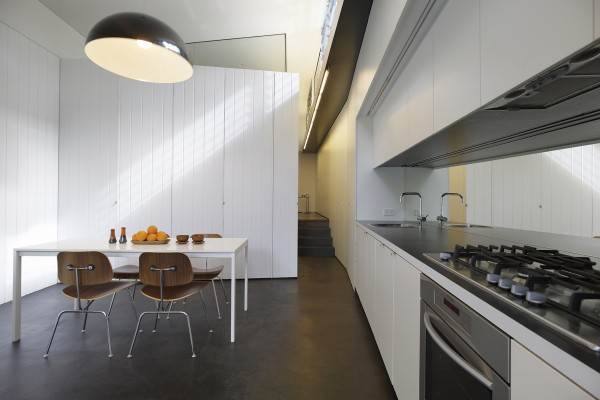 cute galley kitchen after the remodeling and wall redevelopment