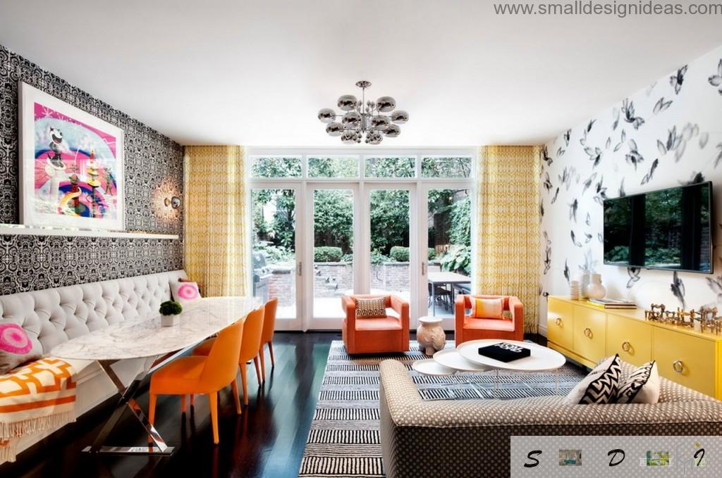 Orange stools as the bright blotch on the face of contemporary living room interior in dark wooden noble colors