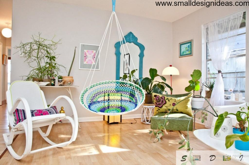 Unique design of spacious living room in eco design with textile suspended blue swing