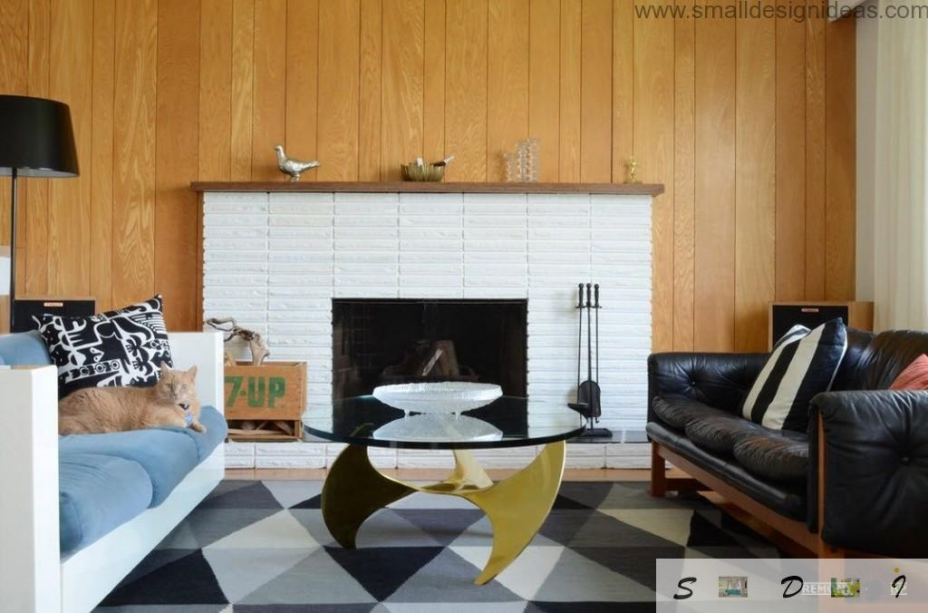 Fireplace and leather sofa - two focal points of the living room interior