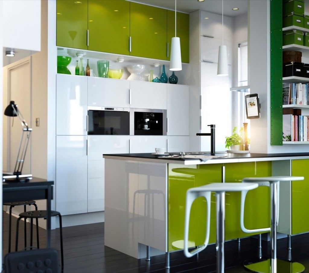 Unique island small kitchen layout with green ecological triming and white cupboard and drawers surfaces