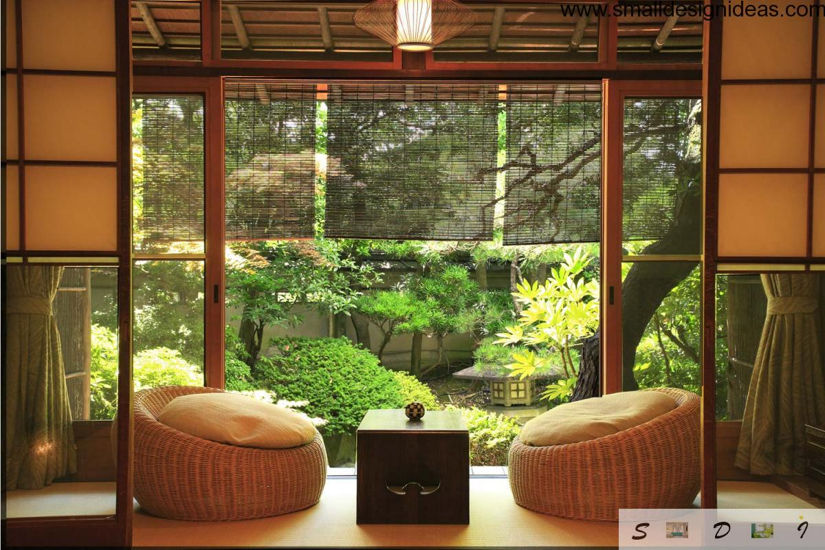 Veranda Of The Country House In Japanese Style With Rattan Puffs And Low Table