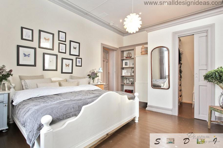 On elevel of the ceiling and many pictures on the wall of bedroom in classic style