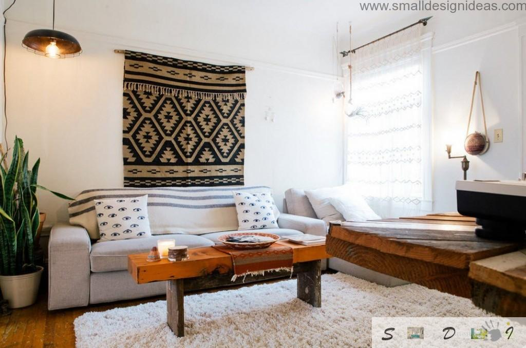 Old rug and wooden coffee table adds some asceticism into the living room