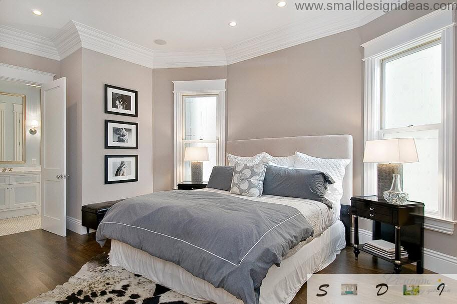 creamy design of the bedroom and pictures as a decoration