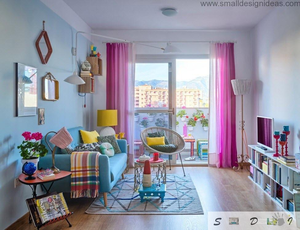 Multicolored living room with wall-tall window with a lot of design elements