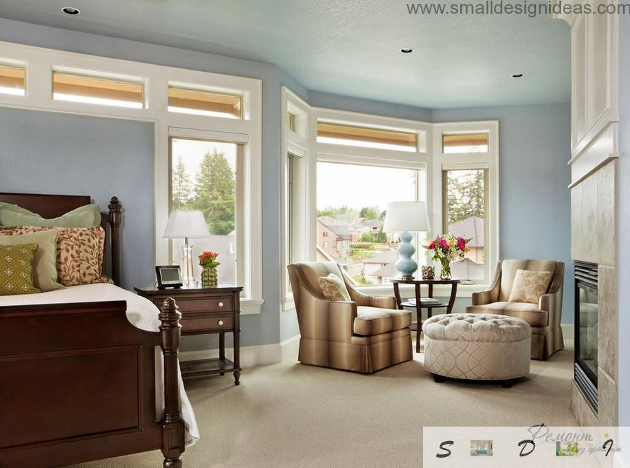 light bedroom classic design with blue tones and lots of upholstered furniture