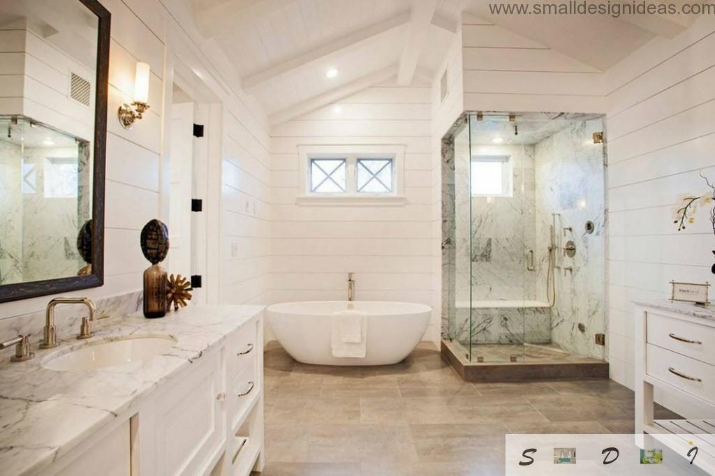 Attic space with bathtub and shower cabine finished with marble
