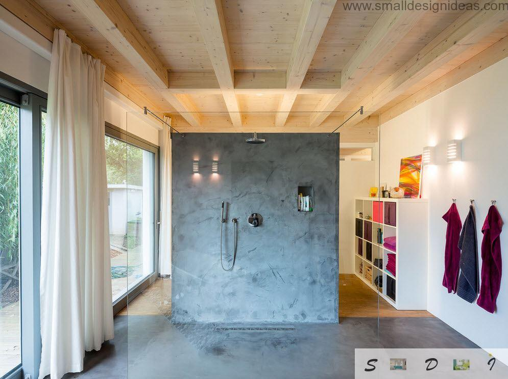 Wooden ceiling and decorative structured plaster with separate dark marble wall in the bathroom looks futuristic