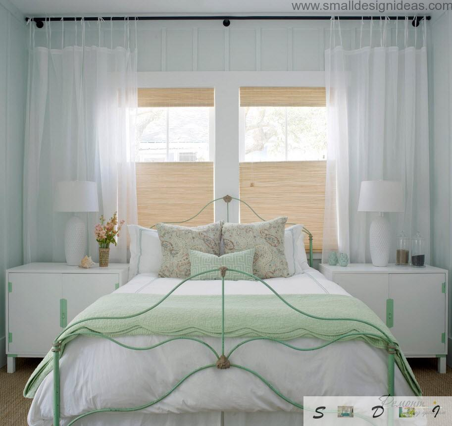 Green bed in the modest classic interior full of tulle and lace details