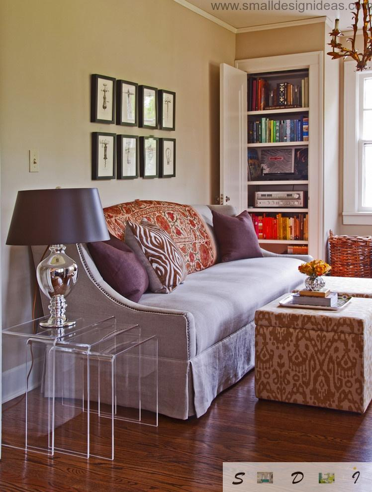 Living room of small size with a lot of upholstery and small furniture to enlarge optical size of the room