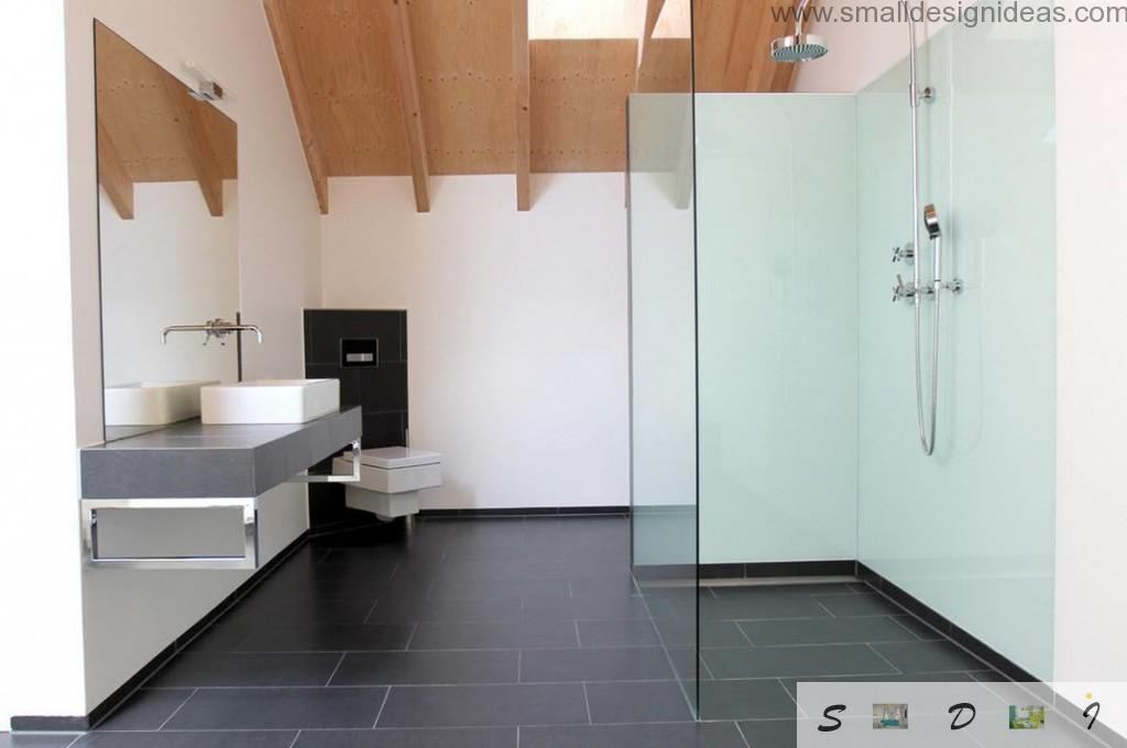 Minimalistic and urbanistic bathroom interior with metro tiled floor and sloped ceiling