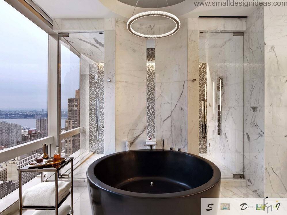 Round black bathtub with marbled wall looks very futuristic