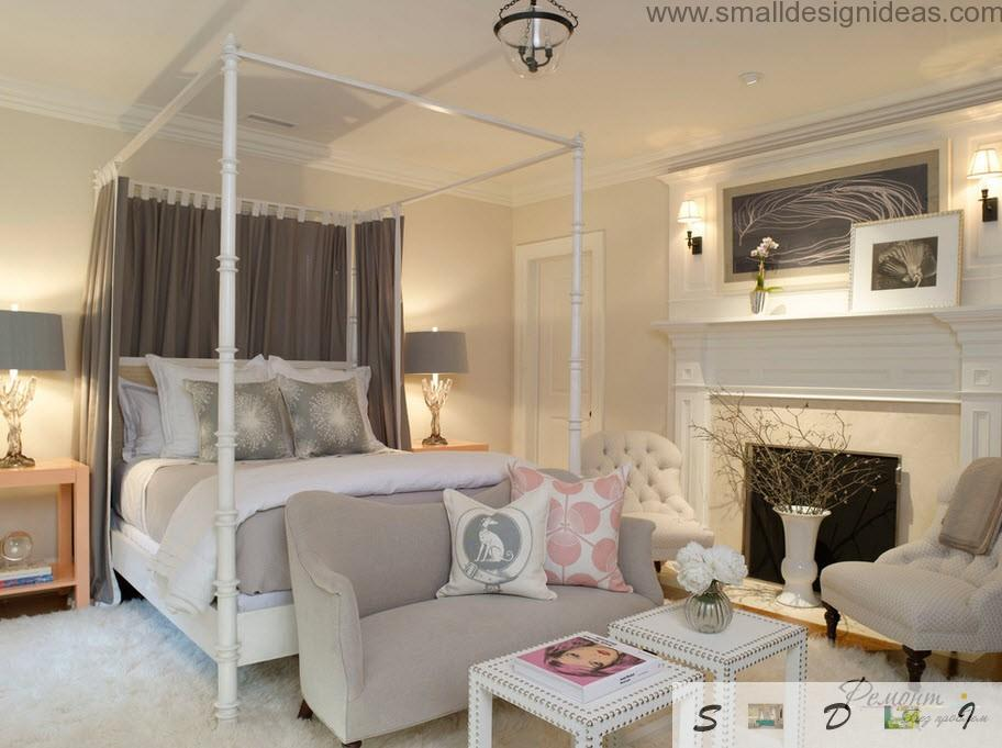 Sociable near big bed with wooden frame and a fireplace in the classic bedroom