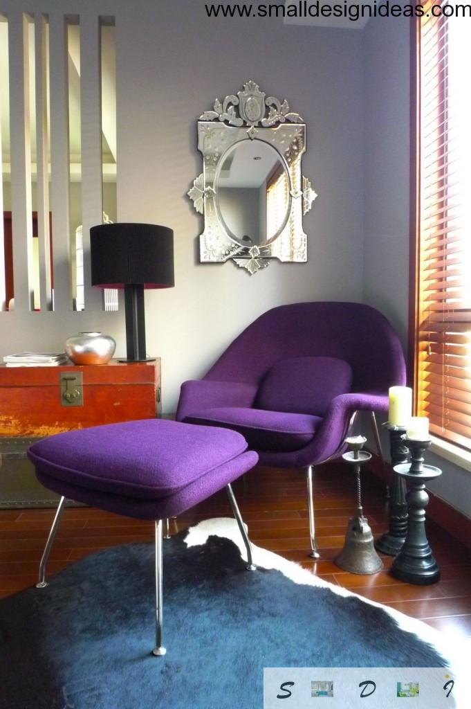 Cozy purple two bodied armchair in the eclectic interior of the living room