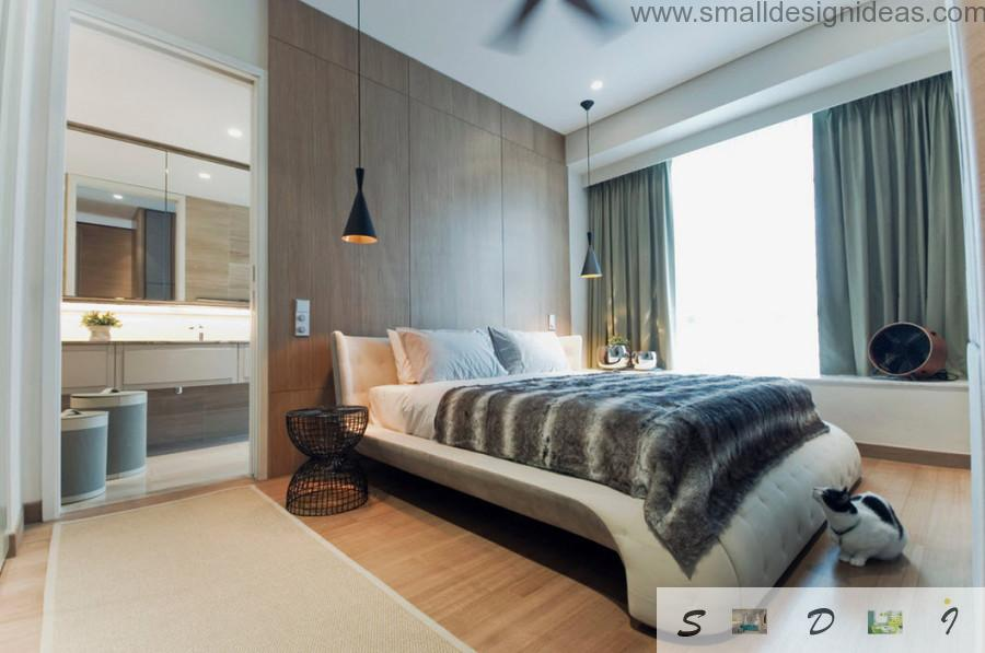 Unique shape and sheeted upholstery of the bed makes this bedroom fresh