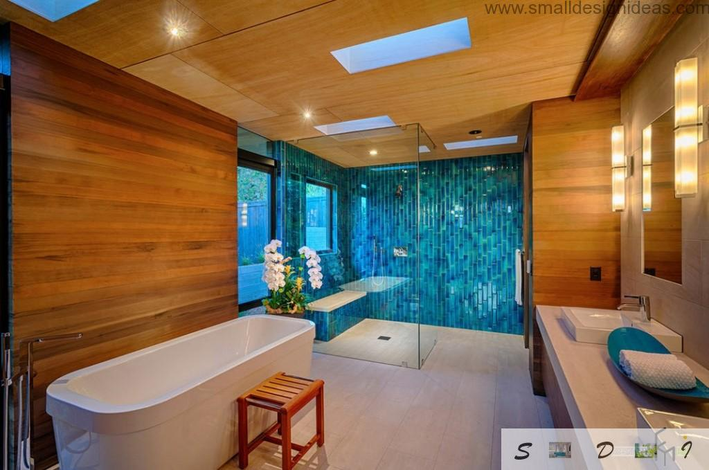 Bright contemporary bathroom interior with wooden and mosaic trim in amber and blue