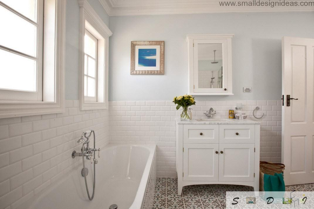 blue picture as a decorative element in the white classic bathroom
