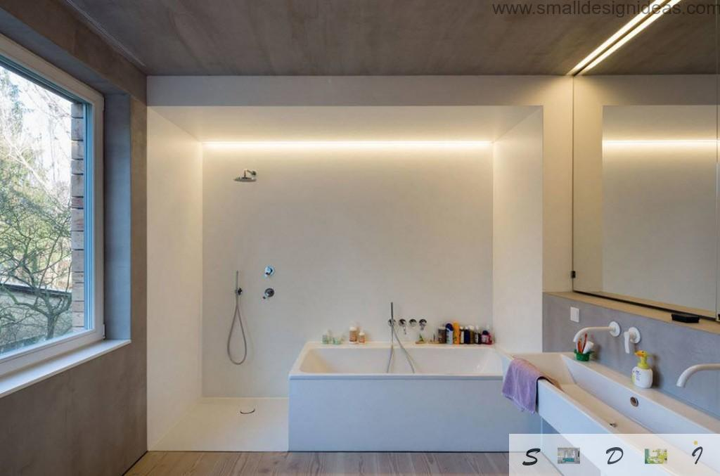 Light cell of the bathroom in the dark blotched textured interior of he overall interior