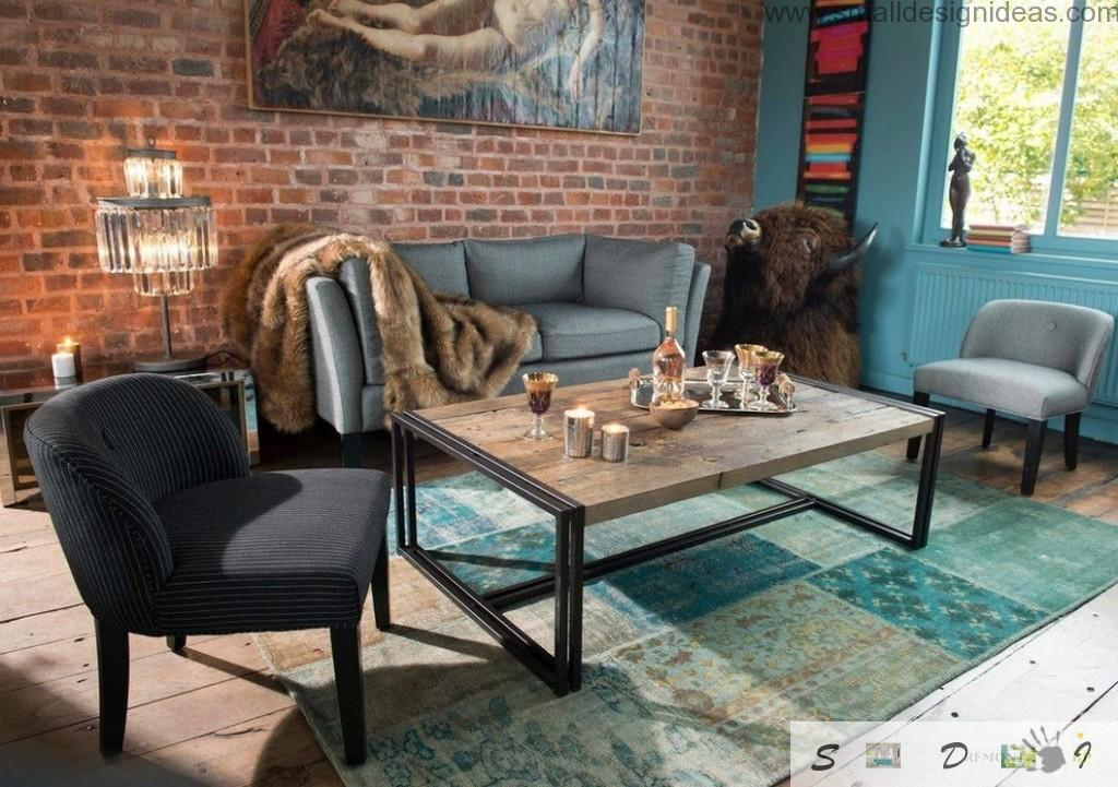 upholstered furniture with bolster and wooden coffee table and masobry on the wall in the living room