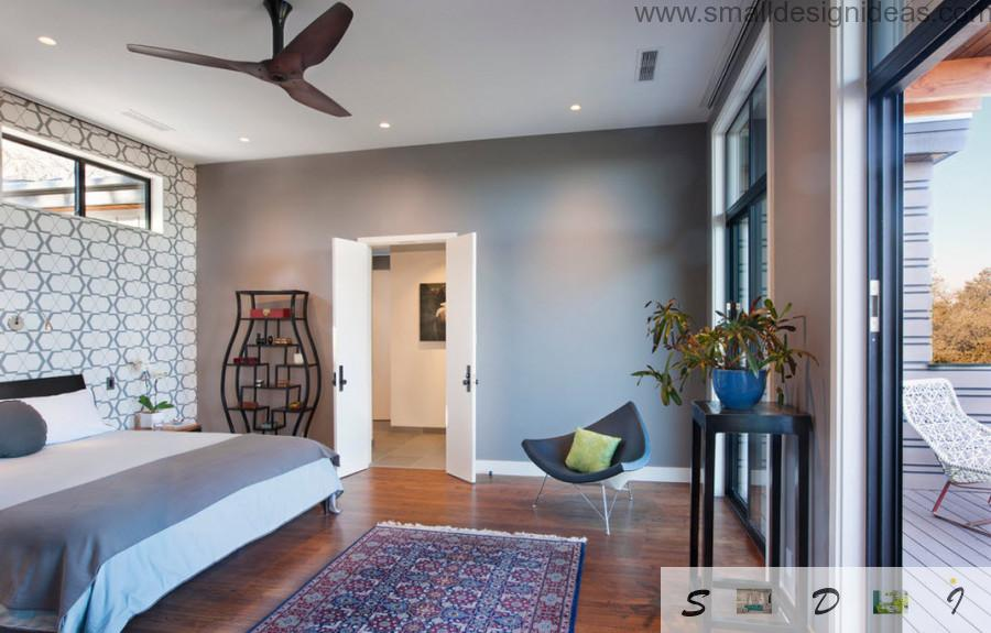 Bedroom in modern style full of decor elements and even fans at the ceiling with spot light
