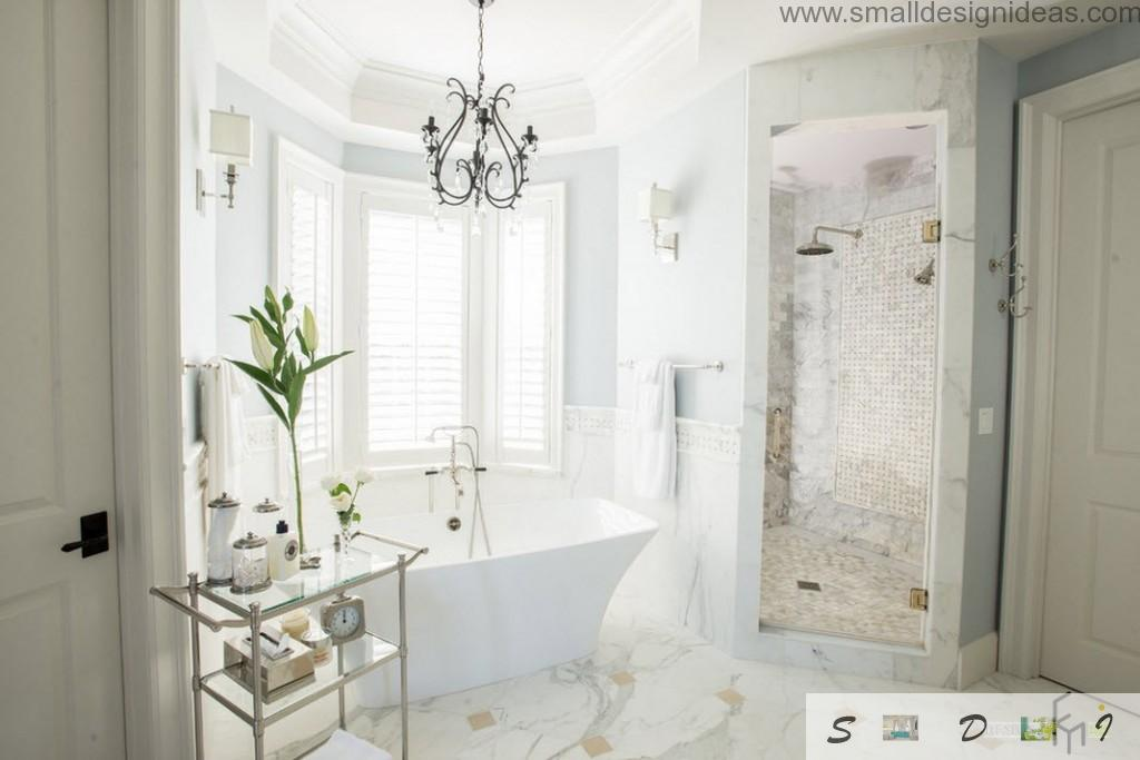 Classic European design of the bathroom with chic shower cubicle and bathroom at the bay window and marble floor