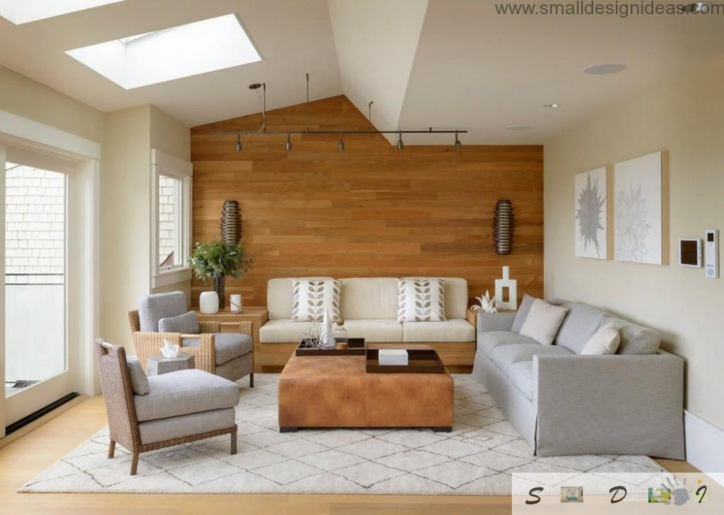 Wooden wall and vaulted ceiling with top window in the design of the living room