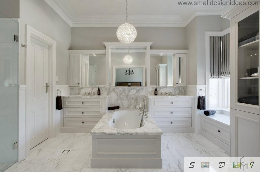 White drawers and marble bathtub in the classic interior