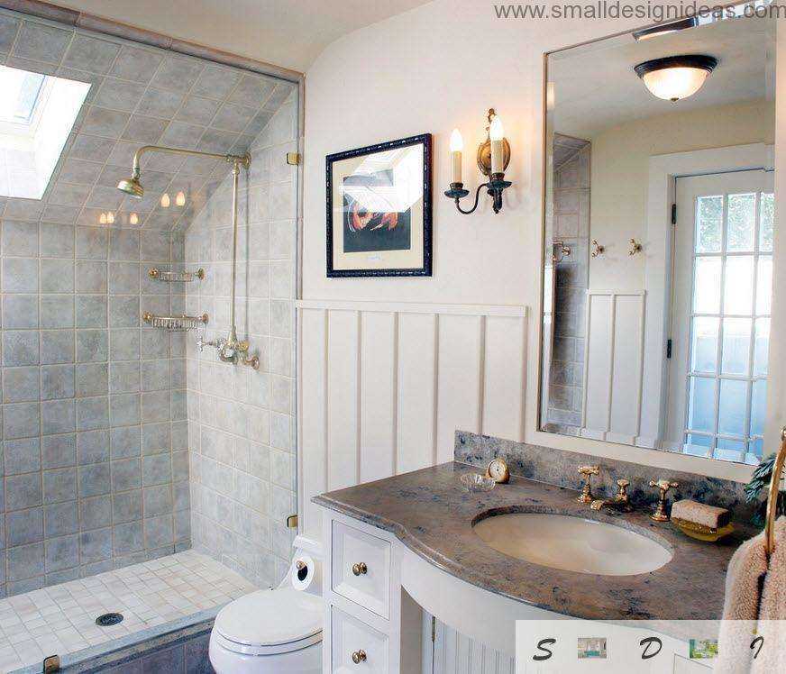 Unique antique style interior if the bathroom with marble surfaces and planes