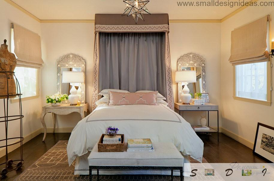 Classic interior in the royal bedroom with big bed and coffe table. Two lamps to enlight the bed