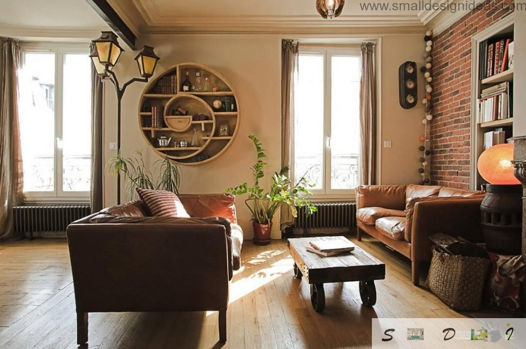 Wooden floor and Asian motiff in the creamy colored living room with upholstered furniture