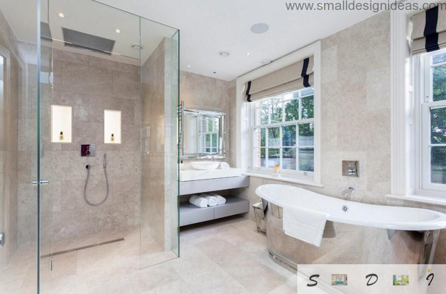 Granite tilr in the modern bathroom interior with wide windows at the countryside house