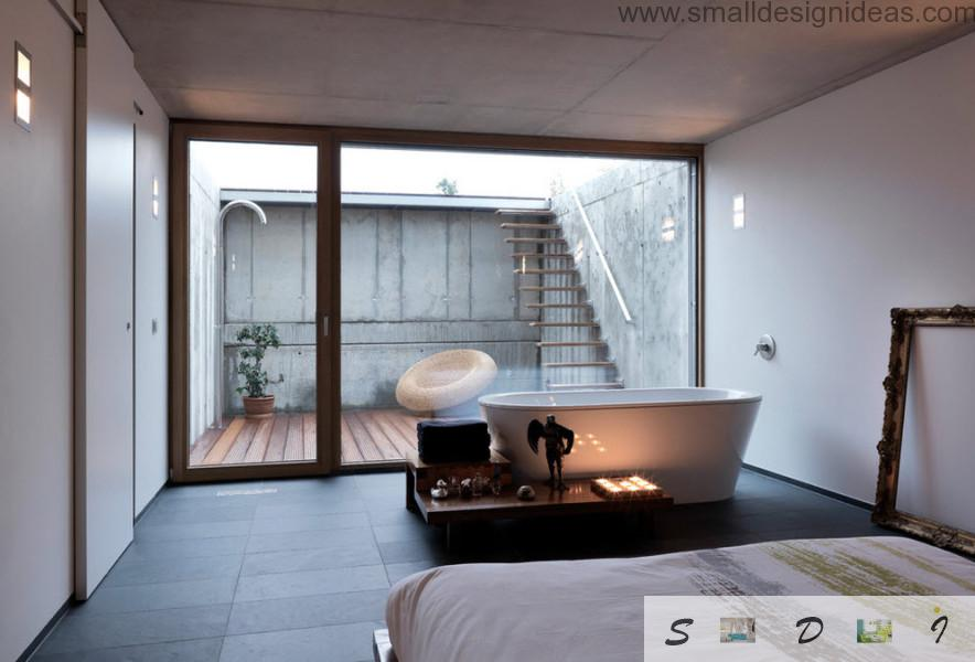 Unique Modern styled bedroom with bathtub and shopwindow looks chic and original