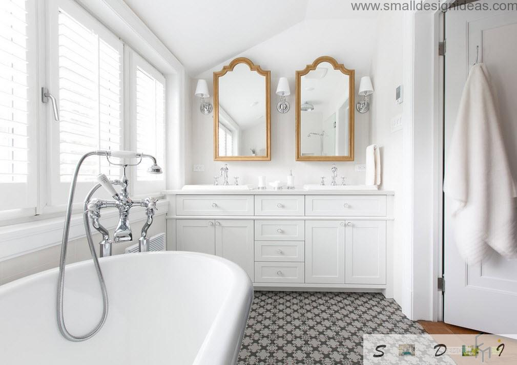 Two mirrors and two sinks in the bathroom for large family