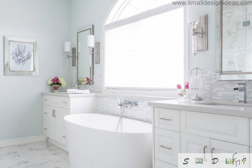 White two sink designed bathroom with unique form of bathtub and steel chrome plumbing