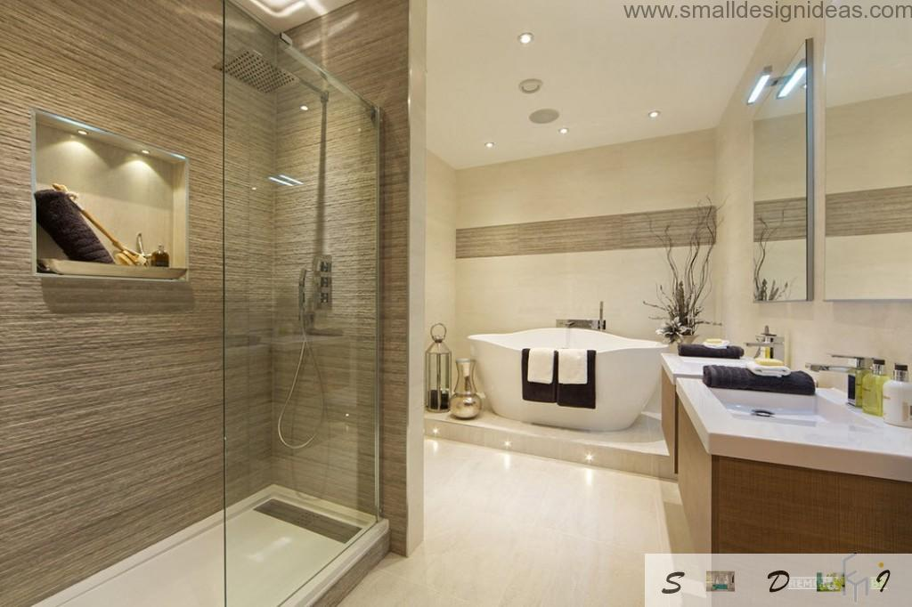 Creamy interior of the bath in cozy modern apartment with all necessary sanitary ware
