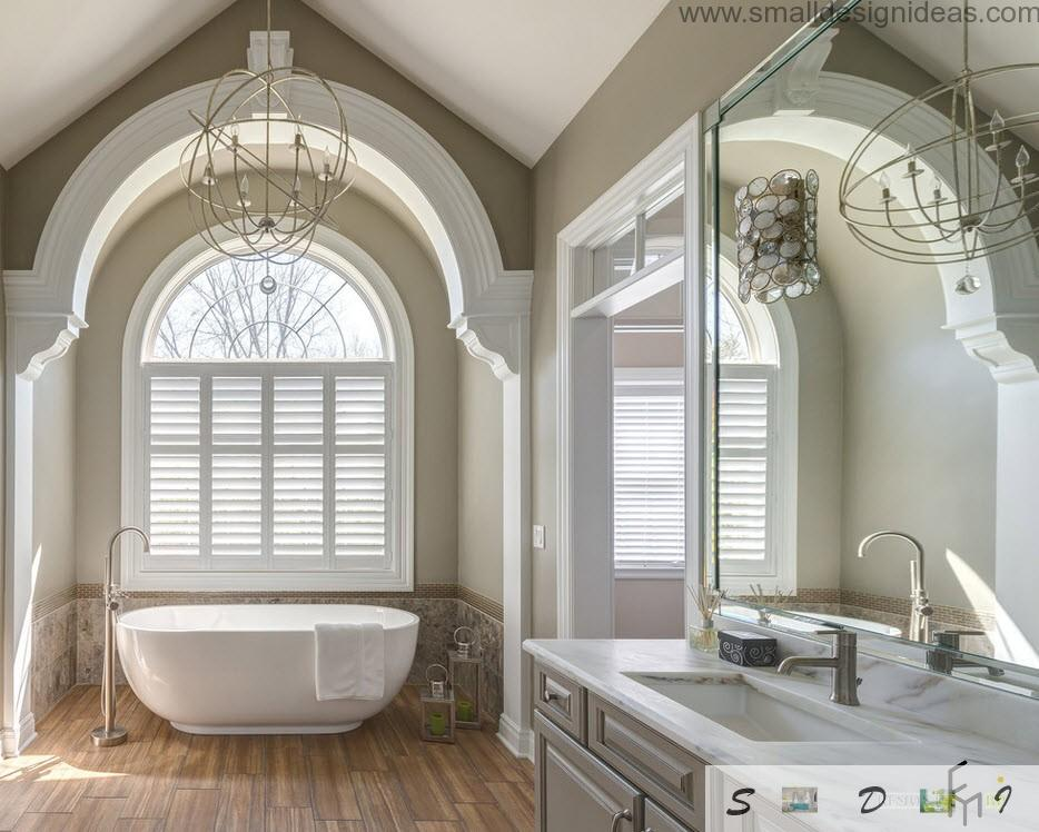 French semioval window and mirror showcase next to the doorpass with transom and little windows in the classic bathroom design