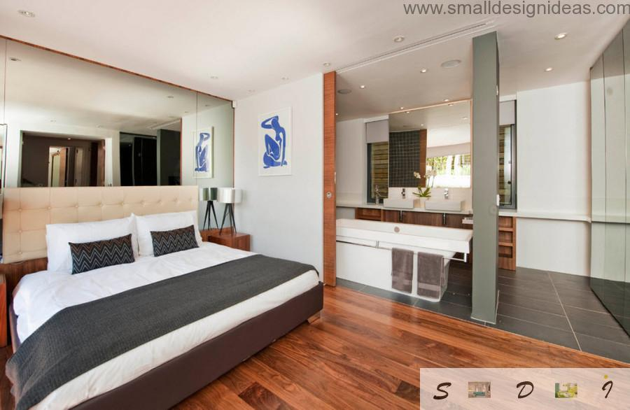 Dark laminate in the modern bedroom full of glass surfaces