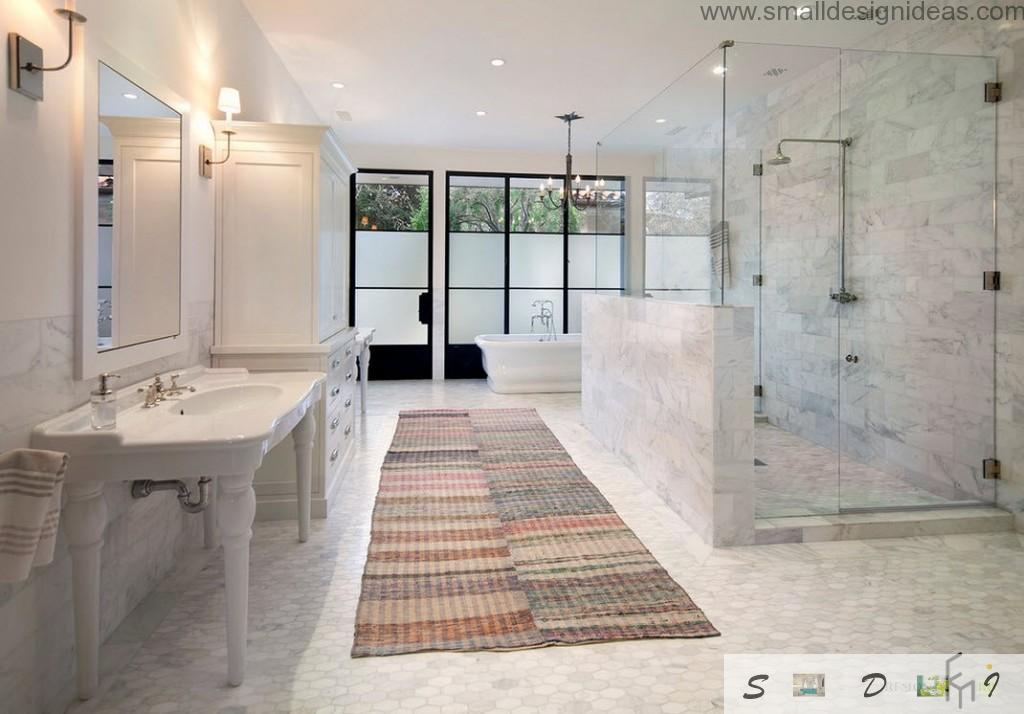 Super roome bathroom looks like sauna with marble trimming and long gur at the floor