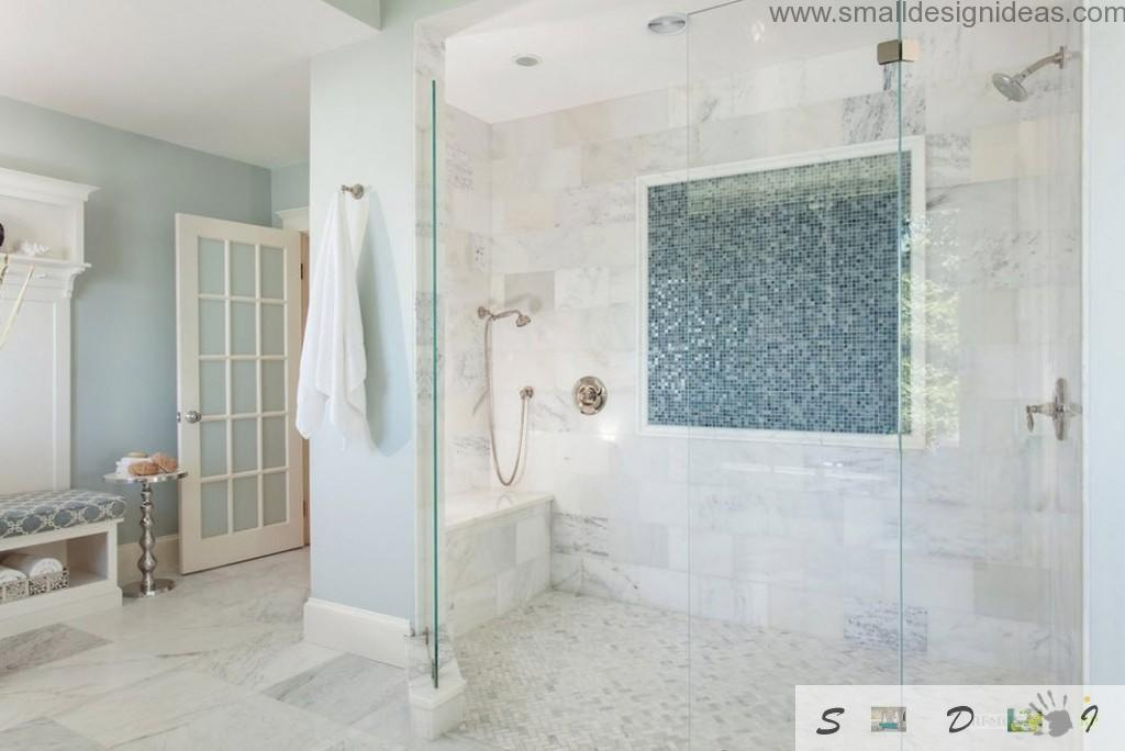 mosaiс tile on the wall of shower cabin of the white bathroom design