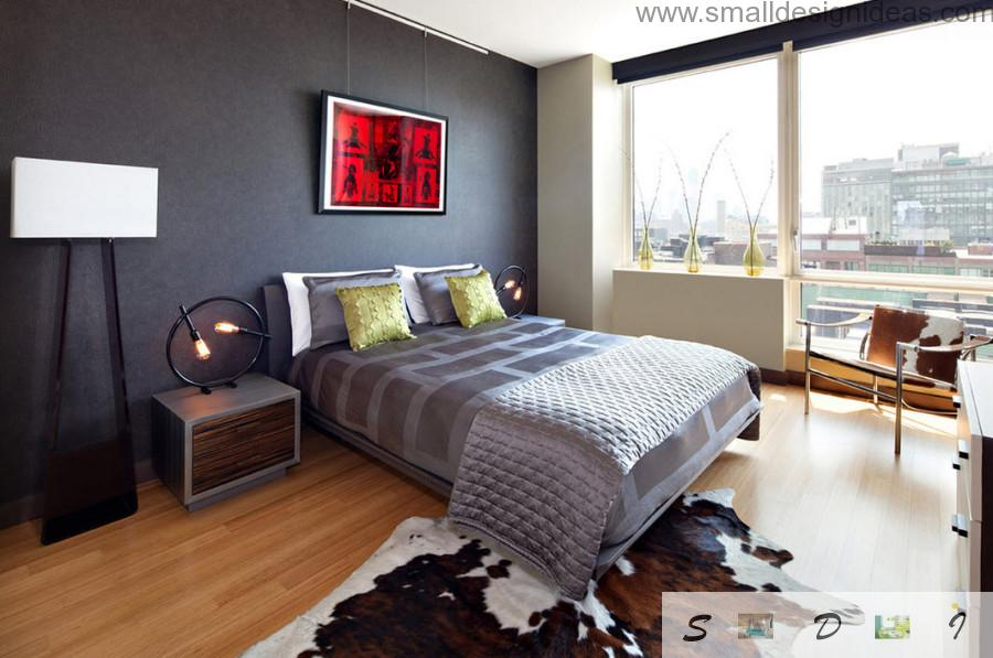Gray bedroom design idea with red picture on the wall