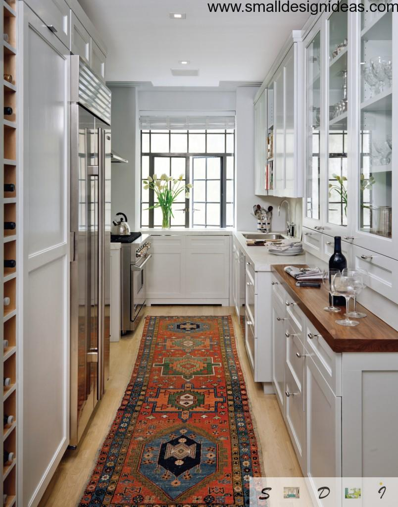 Modern galley kitchen white interior with wooden trimming of surfaces