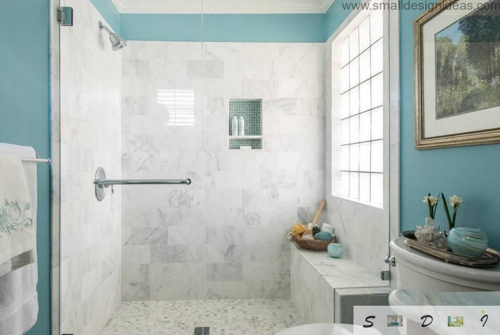 hi-tech bathroom with the marble walls and shower rack