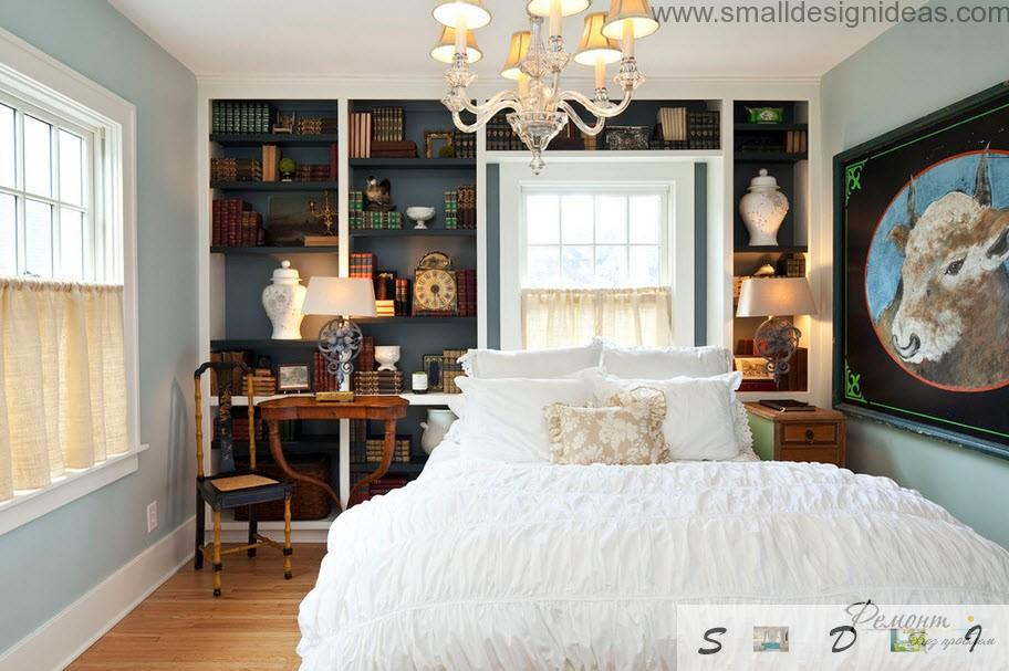 Classic design in the bedroom with books and shelves, and snow-white cover at the bed