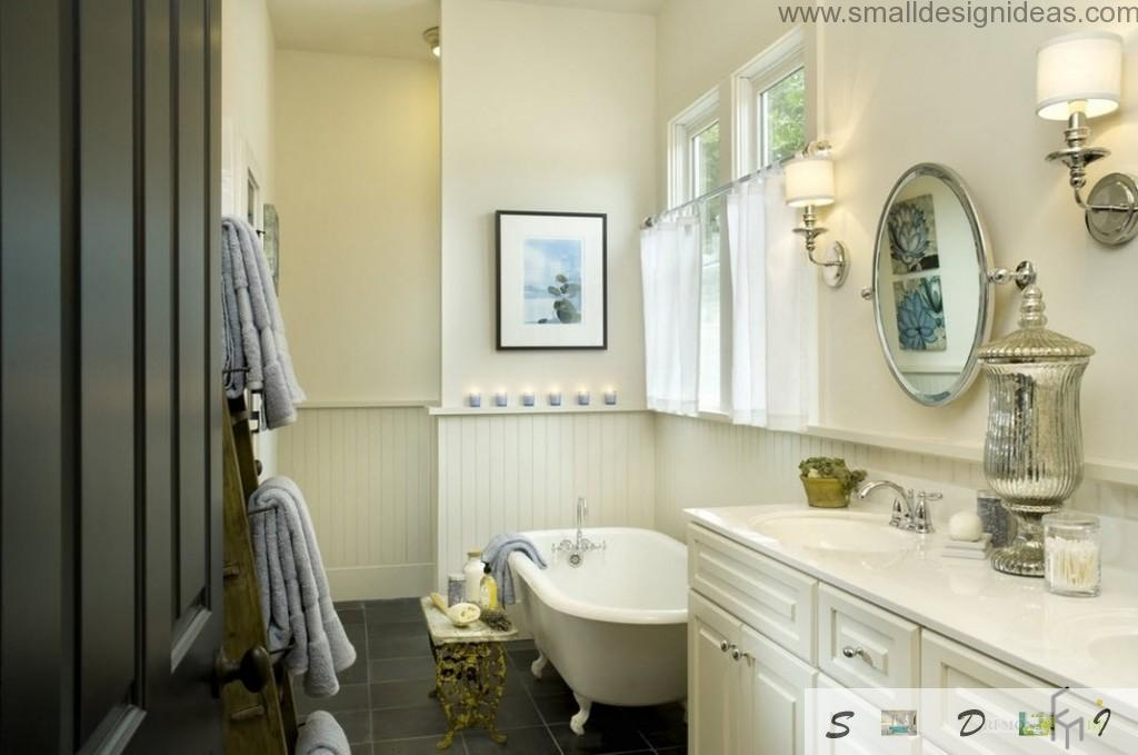 Elaborated bathroom interior with candles at the trimming edge