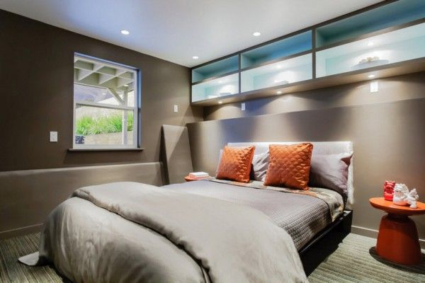 Silver and gray shades in modern minimalistic bedroom and high frame of windows